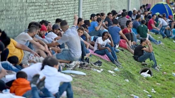 Migrants wait in Tovarnik, Croatia, for transport north on Saturday.