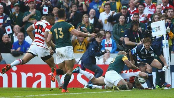 Karne Hesketh scores Japan's winning try against the Springboks at the Brighton Community Stadium.