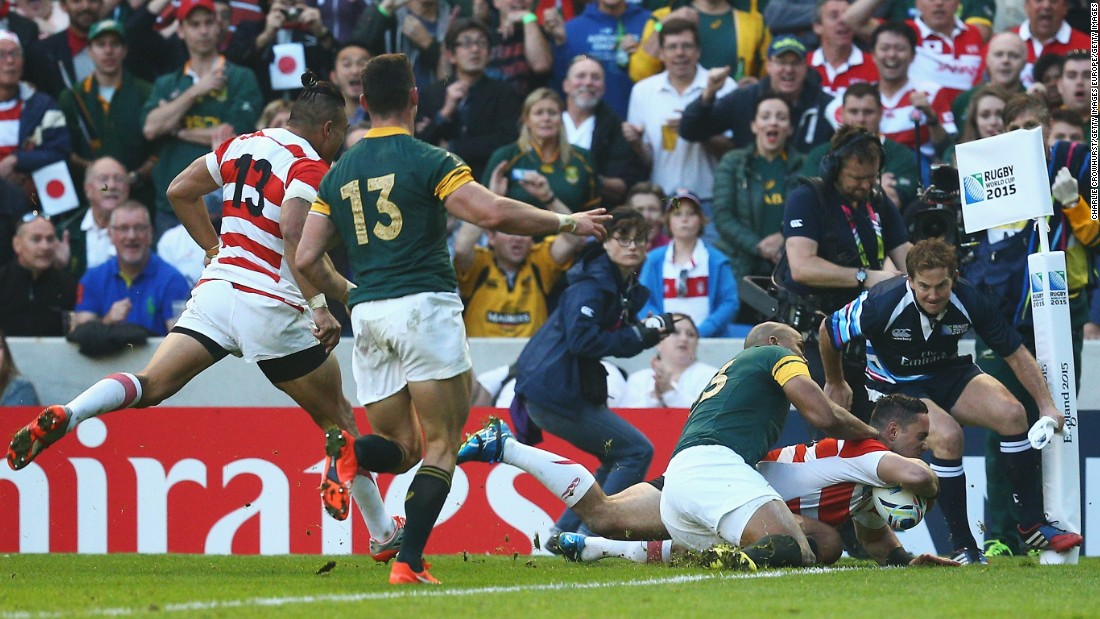 Karne Hesketh scores Japan's winning try against the Springboks at the Brighton Community Stadium.