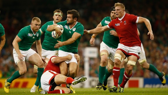 Jared Payne (with ball) scored Ireland's seventh and final try in the Pool D match in Cardiff.