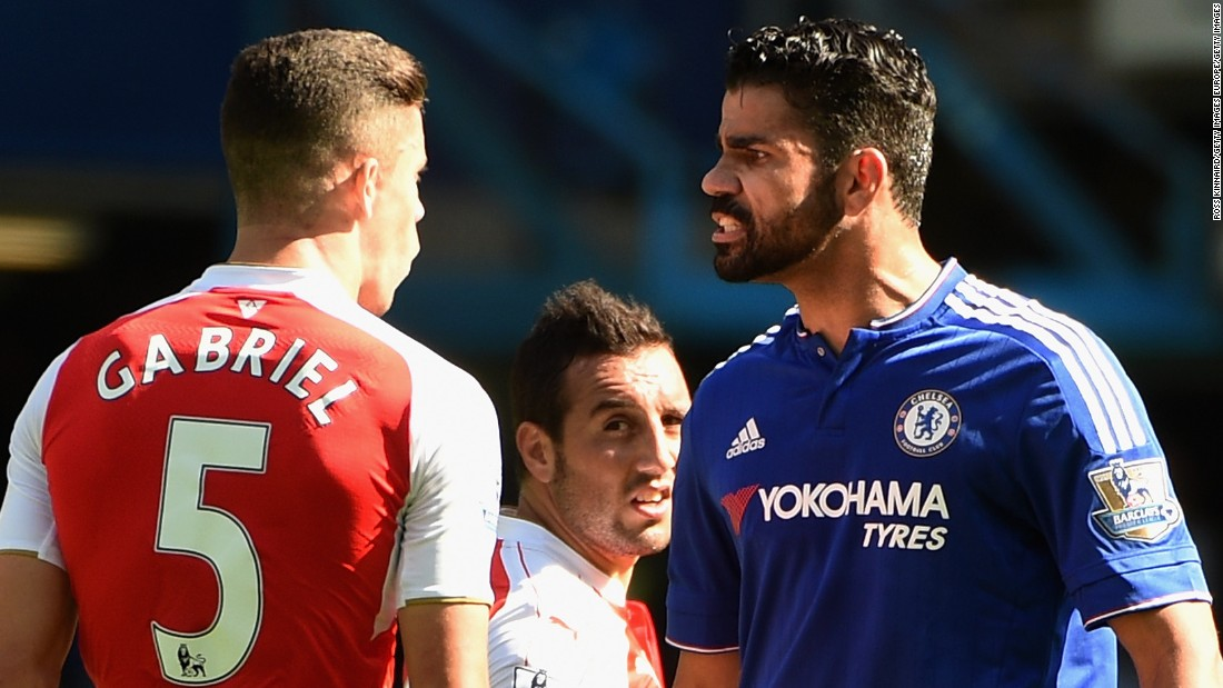 Arsenal defender Gabriel Paulista squares off with Chelsea striker Diego Costa.
