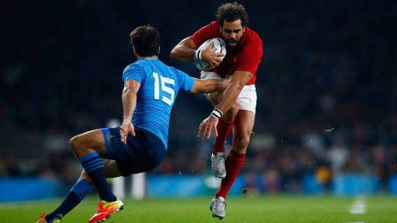 France, beaten in the 2011 final by New Zealand, opened its Pool D campaign on a winning note at Twickenham but winger Yoann Huget (with ball) is expected to miss the rest of the tournament after being carried off with an injury.