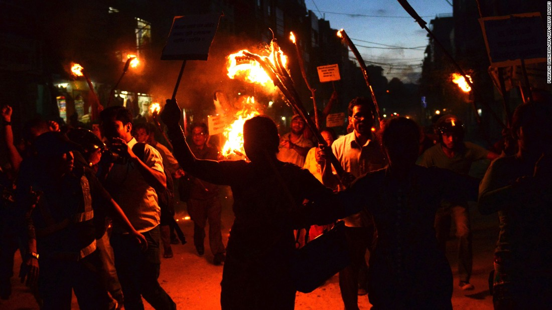 Nepalese activists from marginalised Tharu community take part in a torch rally against the division of Tharu-majority districts in the country's proposed federal structure in Kathmandu on August 11, 2015.