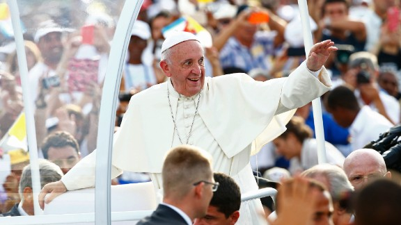 Pope Francis arrives to celebrate Mass in Revolution Square in Havana, Cuba, Sunday, Sept. 20, 2015. Pope Francis opens his first full day in Cuba on Sunday with what normally would be the culminating highlight of a papal visit: Mass before hundreds of thousands of people in Havana
