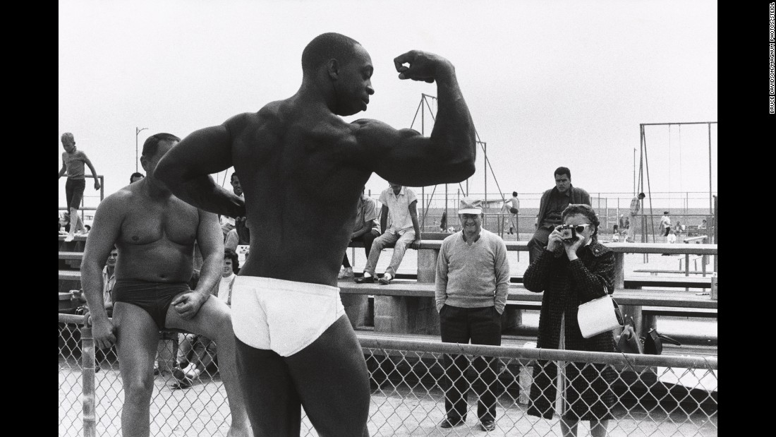 A bodybuilder flexes on Venice Beach. Esquire had sent Davidson to California with the idea that his photos would accompany an article written by someone like Tom Wolfe -- someone who represented an unconventional non-fiction writing style that was being called New Journalism.