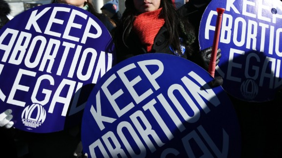 WASHINGTON, DC - Pro-choice activists hold signs as marchers of the annual March for Life arrive in front of the US Supreme Court January 22, 2014. Pro-life activists from all around the country gathered in Washington for the event to protest the Roe v. Wade Supreme Court decision in 1973 that helped to legalize abortion in the United States.  (Photo by Alex Wong/Getty Images)