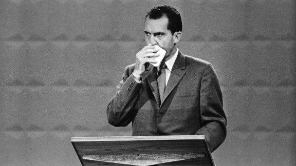 Nixon wipes his face with a handkerchief during the debate.