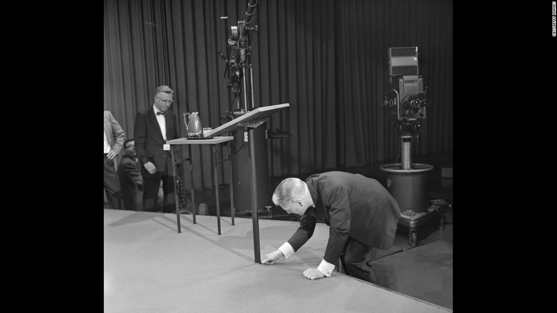 CBS President Frank Stanton fixes the debate stage.