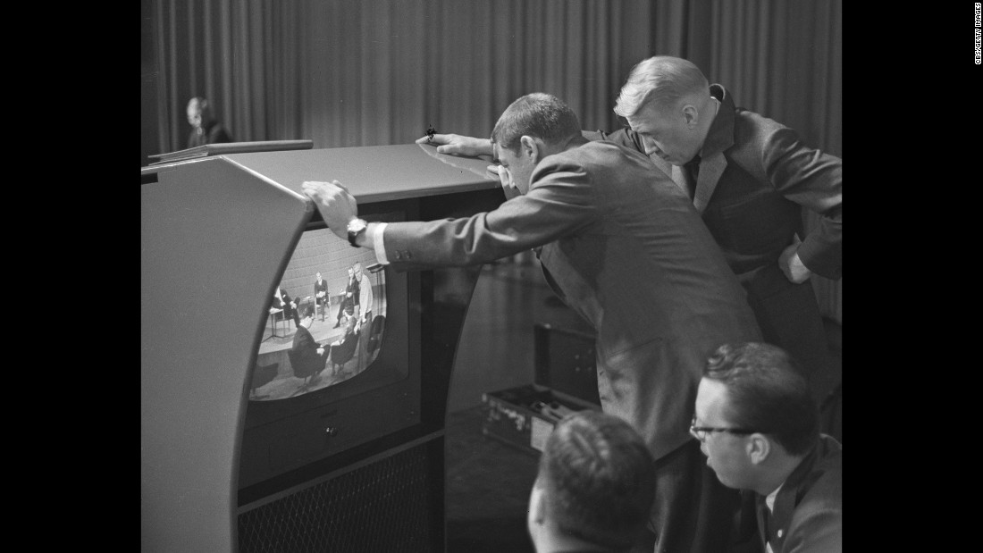 Stanton, right, and producer Don Hewitt check a television monitor before the debate.