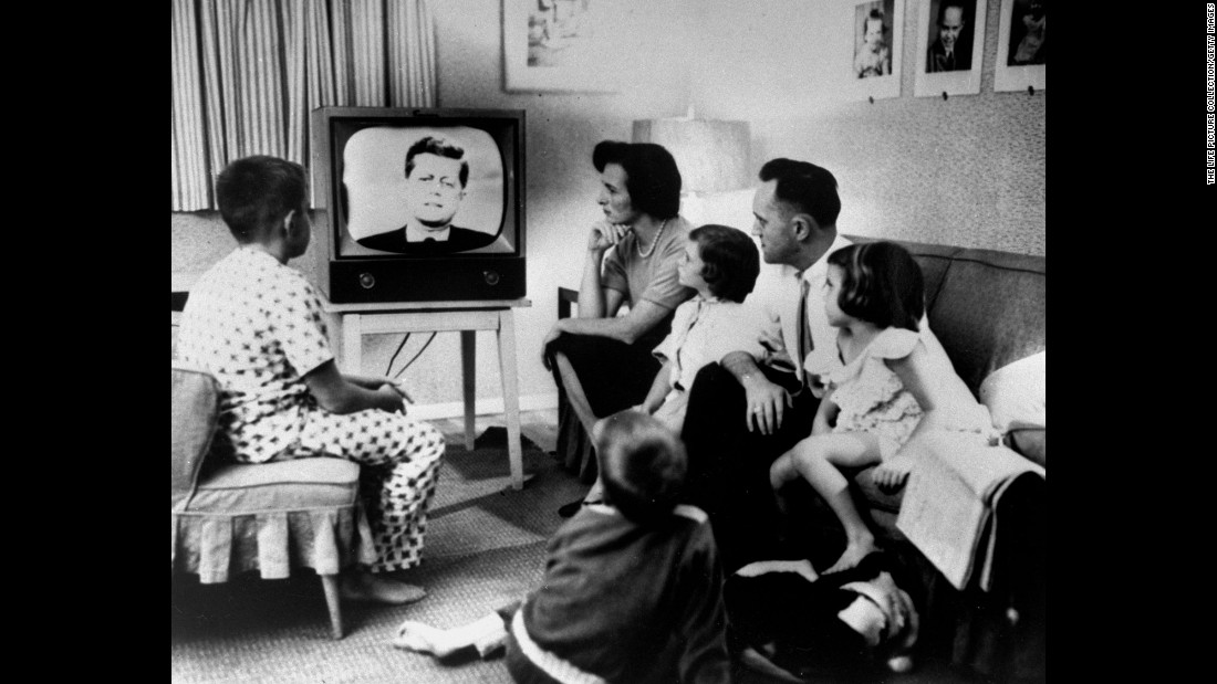 "A family gathers around a television to watch the debate. More than 66 million people watched out of a population of about 180 million. ""I don't think it's overstating the fact that, on that date, politics and television changed forever,"" said Bruce DuMont, a nationally syndicated radio talk show host and president of the Museum of Broadcast Communications. ""After that debate, it was not just what you said in a campaign that was important, but how you looked saying it."""