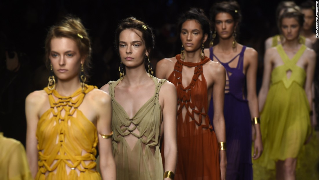 Alberta Ferretti saw models dressed as beautiful, earthy nomads walking down a sandy runway as a screen projected a video of desert dunes overhead.