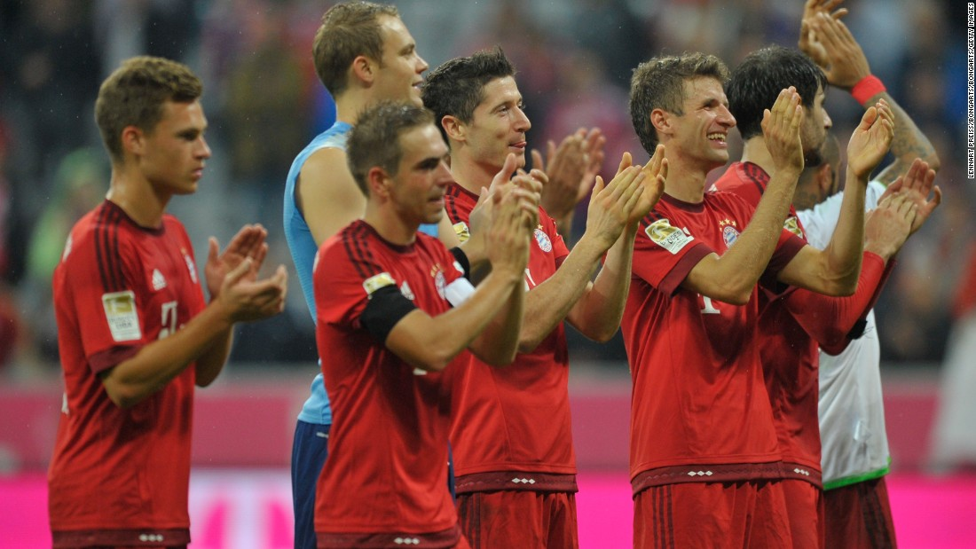 Lewandowski and his Bayern teammates celebrate at the end of the game as they mark the Polish striker's mesmerizing individual performance.