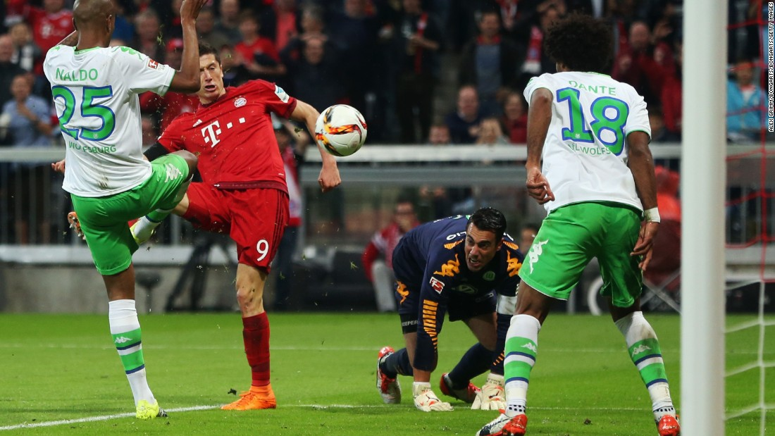 VfL Wolfsburg's Naldo, Dante and goalkeeper Diego Benaglio are powerless to prevent Lewandowski scoring his third goal threes minutes later. By this point he had been on the pitch for nine minutes, breaking another Bundesliga record.