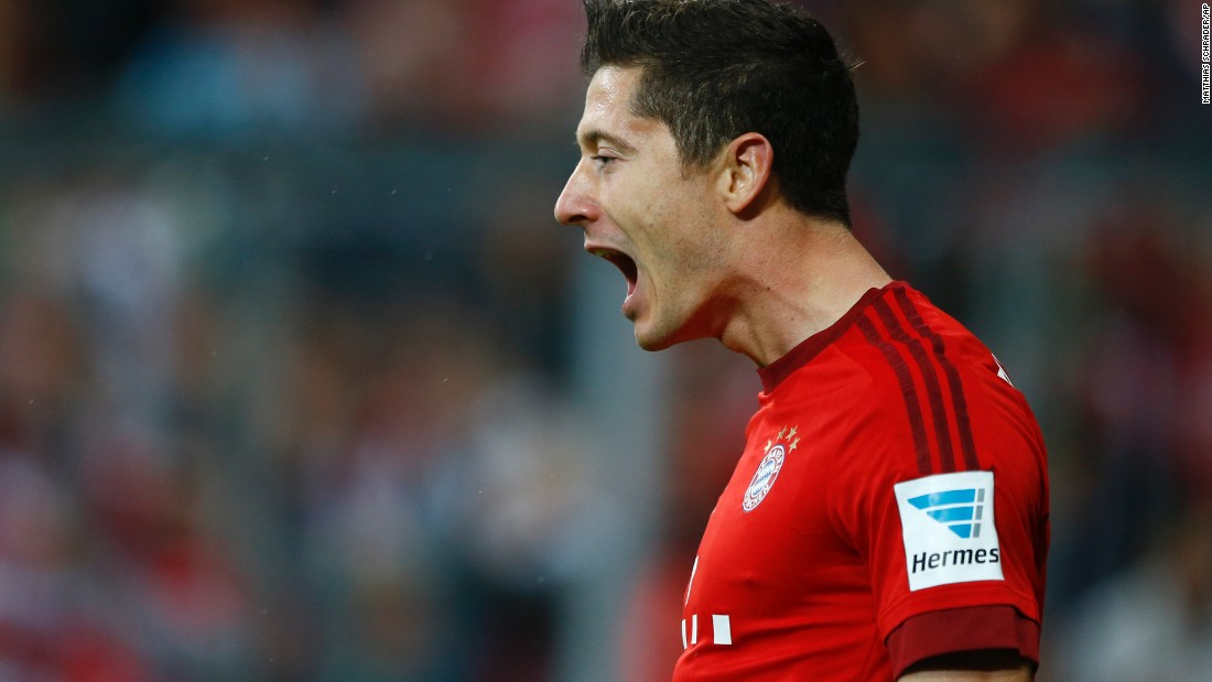 Bayern Munich striker Robert Lewandowski celebrates after scoring during the German Bundesliga soccer match against VfL Wolfsburg at the Allianz Arena stadium. The Polish international made Bundesliga history by scoring five goals in the space of nine minutes as Bayern came from behind to rout Wolfsburg 5-1.