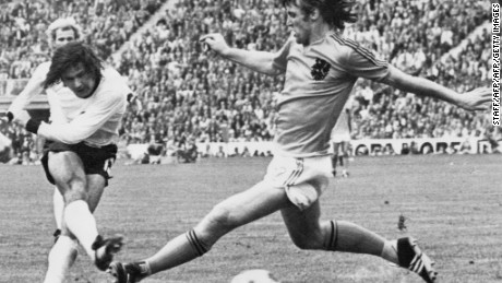 """Der Bomber,"" Gerd Muller (L) scores the second goal for West Germany despite being pressured by Dutch defender Rudi Krol, on the 7th July 1974 in Munich, during the World Cup final. West Germany defeated the Netherlands 2-1."
