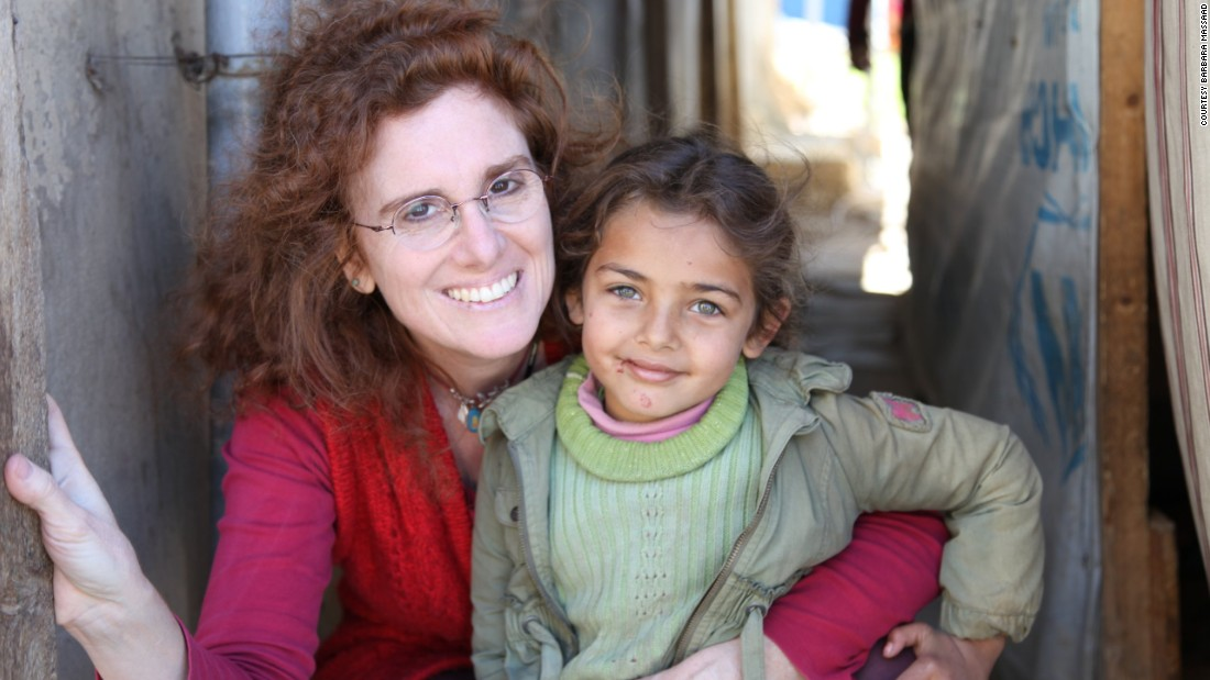 "Barbara Massaad poses with a refugee child at the Zahle Lebanon. Her experience at the camp inspired her to create the humanitarian cookbook ""Soup for Syria."""