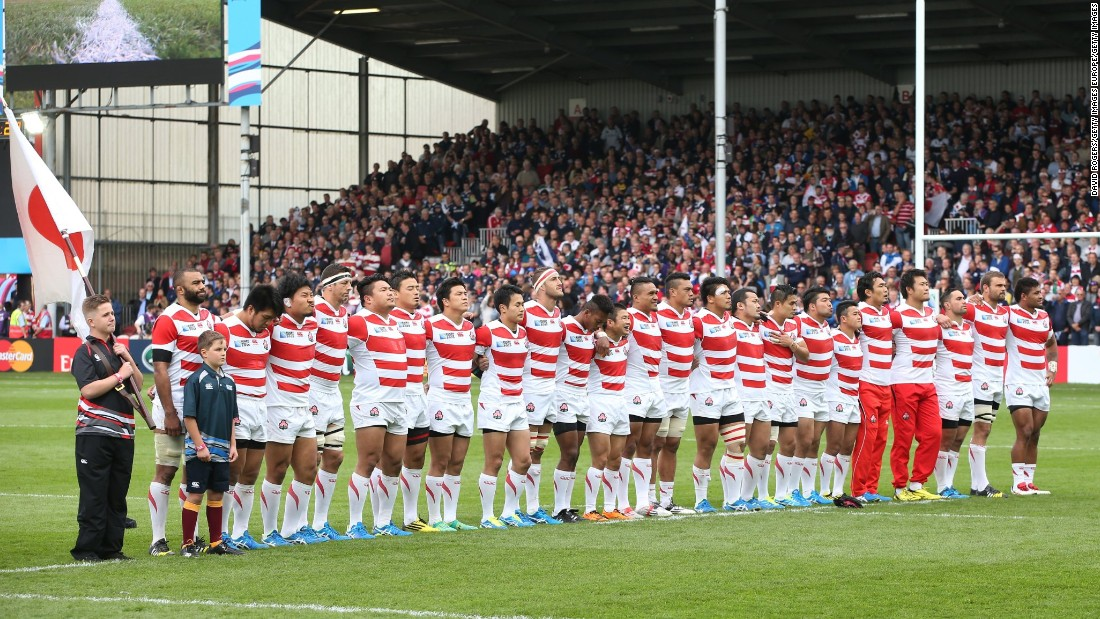 The Japan team line up for the national anthems ahead of the clash with Scotland.