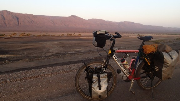 Resting the bike in Djibouti. Rutland says the pressure of needing to finish in time for the Rugby World Cup spurred him on through exhaustion.