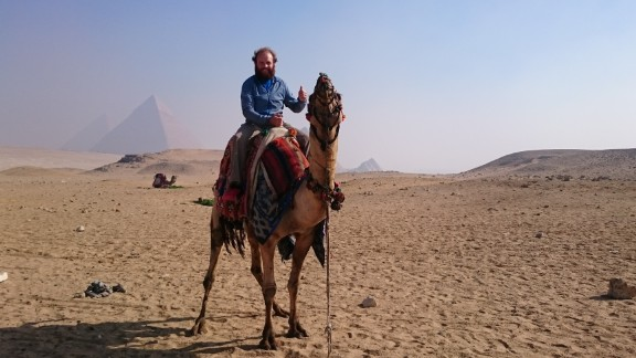 "Rutland says he rested from the bike whenever he needed to, taking a few days off to ease the muscles. ""I was completely unfit when I started."" Pictured, enjoying a camel ride in Egypt."