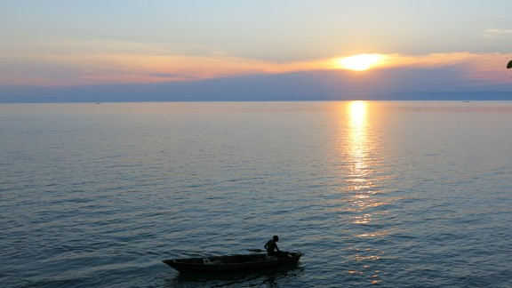 """I knew more of Asia and Europe than I did of Africa, so part of the motivation was to explore my own continent. Africa is the iconic continent of adventure."" Pictured, sunset on Lake Tanganyika, Burundi."