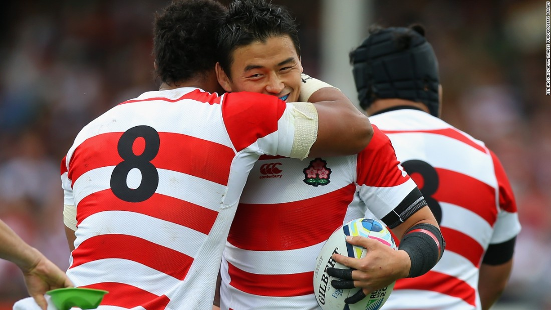 Japan players celebrate the try by Mafi, who was one of six changes to the side made by coach Eddie Jones following the win over South Africa.