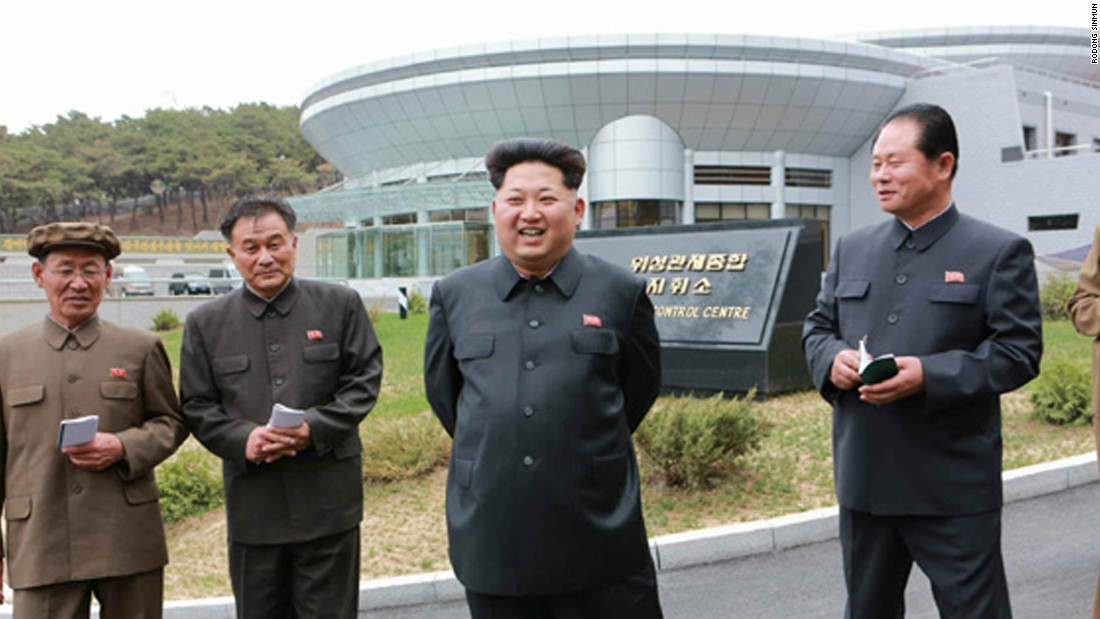 Kim Jong Un, the supreme leader of North Korea, poses in front the satellite control center during an undated visit believed to be earlier this year.