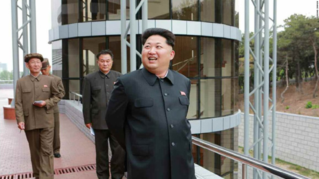 Kim Jong Un is pictured smiling during his visit to the satellite control center.
