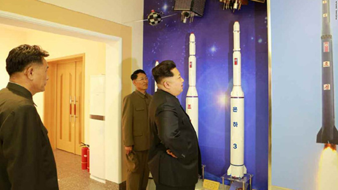 Kim Jong Un inspects models and illustrations of rockets inside the satellite control center.