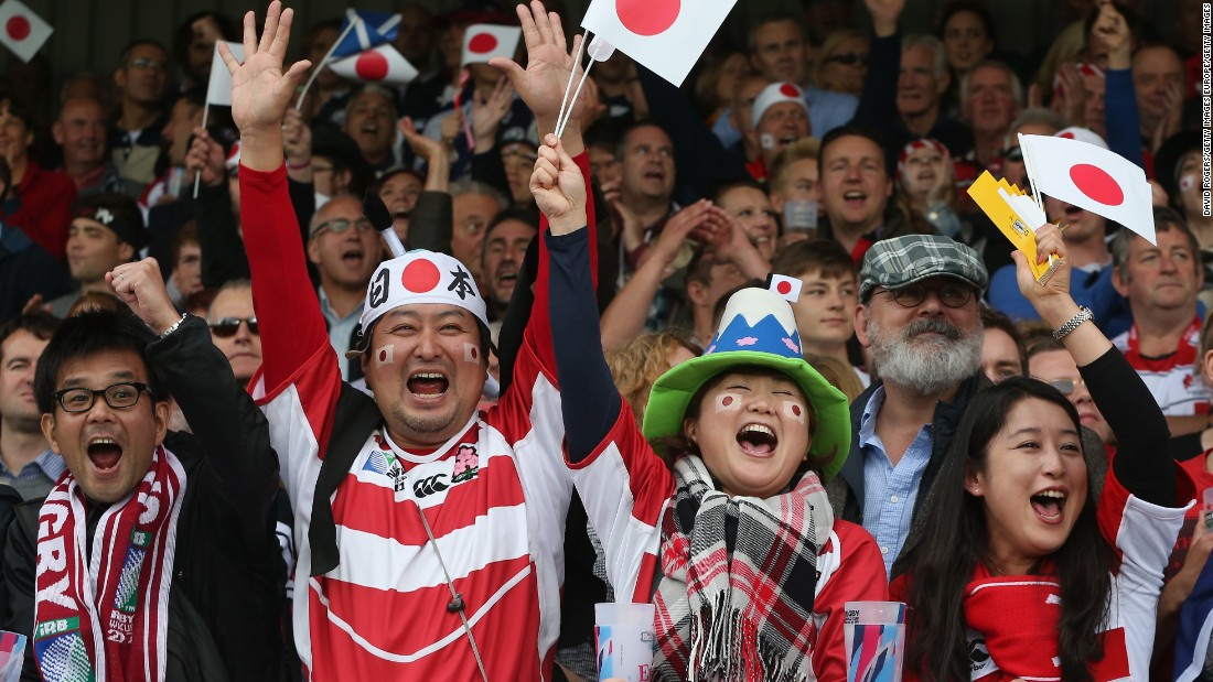 Japan supporters celebrate Mafi's try against Scotland.