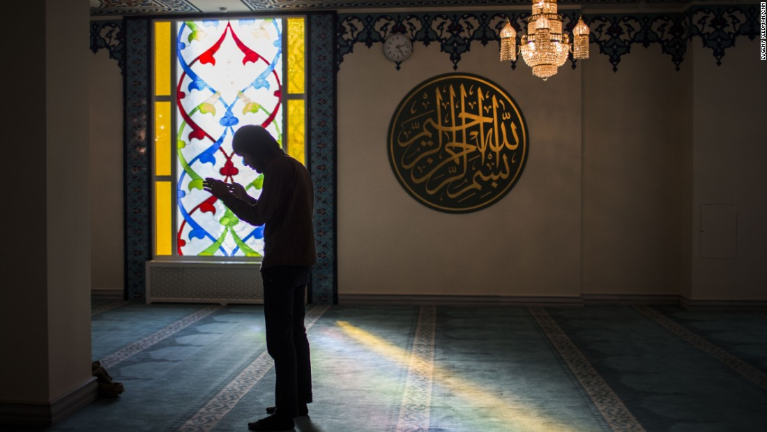 A Muslim prays in the mosque on the evening of its opening.