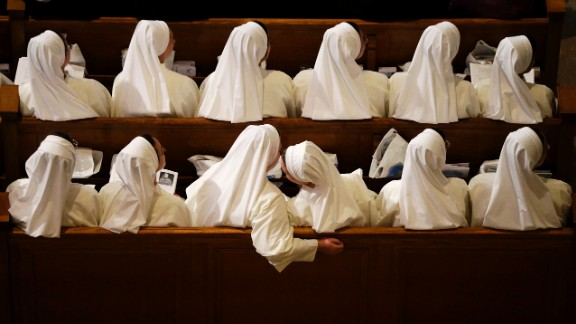 Nuns wait for Pope Francis to arrive inside the Basilica of the National Shrine of the Immaculate Conception.