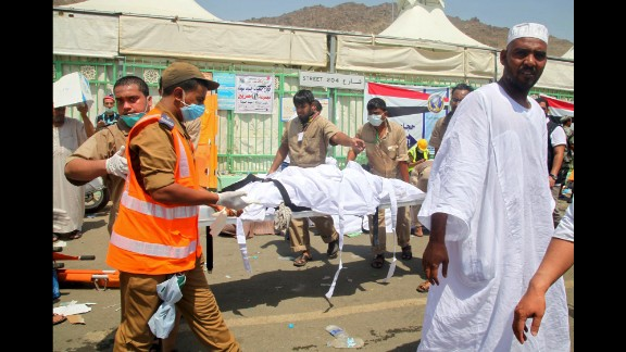Saudi emergency personnel carry a body.