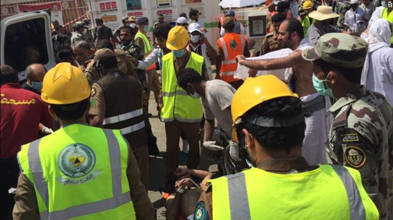 In this image posted on the official Twitter account of the directorate of the Saudi Civil Defense agency, rescuers respond to a stampede that killed and injured pilgrims in the holy city of Mina during the annual hajj pilgrimage on Thursday, Sept. 24, 2015. (Directorate of the Saudi Civil Defense agency via AP) MANDATORY CREDIT