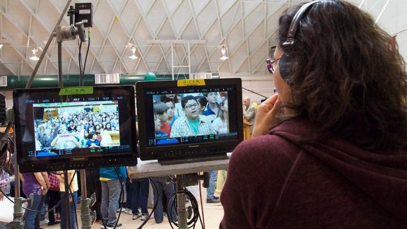 """Rico Rodriguez of TV's """"Modern Family,"""" on monitor, leads an all-Latino cast in """"Endgame,"""" directed by Carmen Marron, right."""