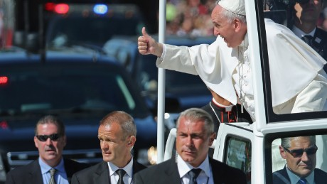 WASHINGTON, DC - SEPTEMBER 23:  Pope Francis leans out and waves to the crowd as he rides in a popemobile along a parade route around the National Mall on September 23, 2015 in Washington, DC. Thousands of people gathered near the Ellipse to catch of glimpse of Pope Francis after he addressed an audience of 15,000 invited guests on the South Lawn of the White House during an official arrival ceremony with President Barack Obama. The Pope began his first trip to the United States at the White House followed by a visit to St. Matthew's Cathedral, and will then hold a Mass on the grounds of the Basilica of the National Shrine of the Immaculate Conception.   (Photo by Chip Somodevilla/Getty Images)
