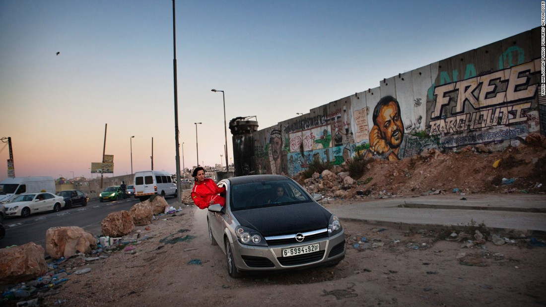 "Jordanian photographer Tanya Habjouqa focuses on gender, social, and human rights issues in Palestine. Here, Mona Ennab, a ""Speed Sister"" from Ramallah, trains with colleague Noor Daoud at the Qalandia check point during a quiet lull in Ramadan. Open spaces for practicing racing and drifting are limited in the West Bank.<br /><br />Habjouqa: ""The speed sisters, the first all female auto racing team in the Middle East represent all that is beautiful within the West Bank. During this moment, they took the opportunity, at the very edge of possibility, to find a place to train."""