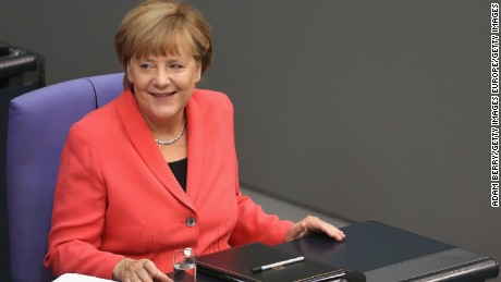 BERLIN, GERMANY - SEPTEMBER 24:  German Chancellor Angela Merkel (CDU) smiles after speaking in the Bundestag, the German federal Parliament, about the ongoing refugee crisis, on September 24, 2015 in Berlin, Germany. The European Union, after deciding upon a controversial quota system to divide the recent influx of migrants throughout Europe, will give an additional one billion euros (1.1 billion USD) to United Nations agencies dealing with the refugee crisis, according to a draft statement by officials who met in Brussels the previous day.  (Photo by Adam Berry/Getty Images)