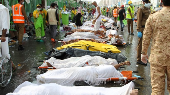 Saudi emergency personnel surround bodies of Hajj pilgrims at the site of a stampede Thursday, September 24, in Mecca, Islam