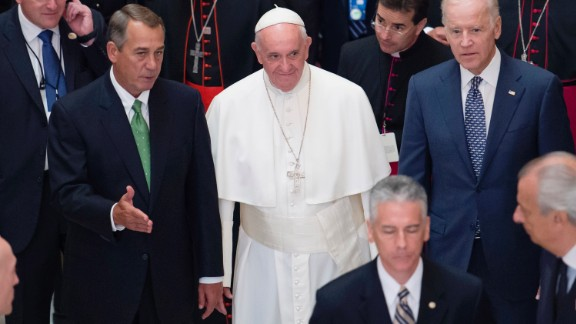Pope Francis walks with Speaker Boehner and Vice President Joe Biden after delivering a speech to Congress in Washington on September 24.