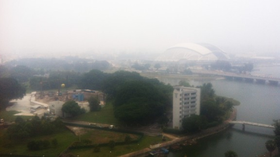 The hazy view of Singapore from the balcony of local resident Iain Craig.