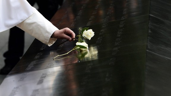 Pope Francis places a white rose at the 9/11 memorial in New York on September 25.