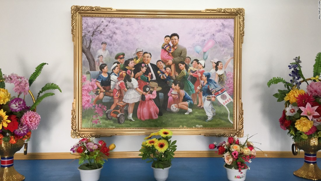 North Korean founder Kim Il Sung, who died in 1994, and his son Kim Jong Il, who died in 2011, are surrounded by beaming children in this popular painting. The supreme leaders visited the Jang Chon cooperative farm on multiple occasions -- the founder himself made 16 trips.