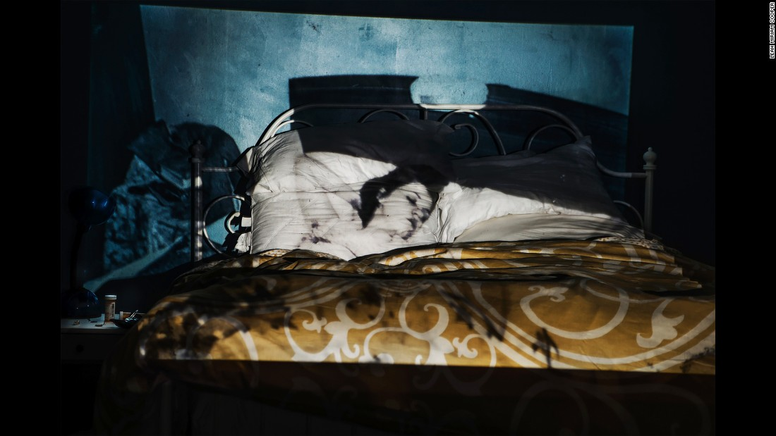 An image of Hannah, sleeping in 1942, is projected onto Cooper's bedroom.