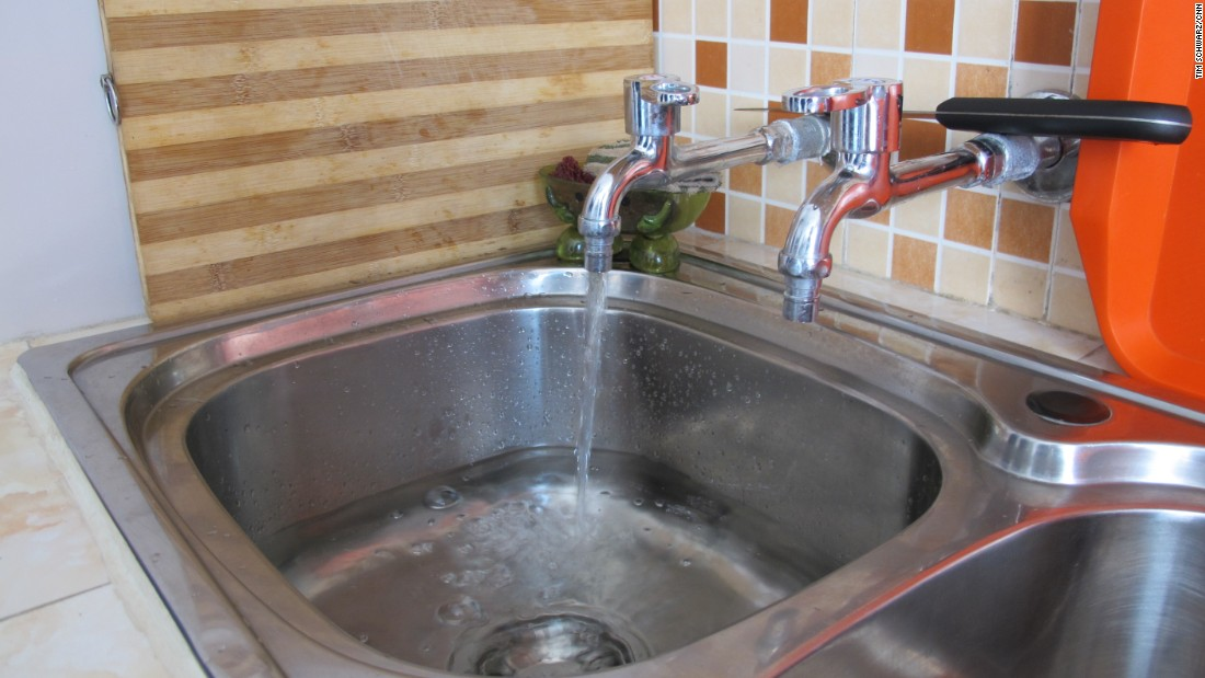 A sink with two faucets is spotted inside a model apartment -- an innovation not often seen in farmers' apartment. Unfortunately, the hot water faucet was not working when CNN visited. Hot water is only supplied at certain times, we were told.