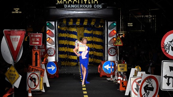 At Moschino, Jeremy Scott pushed the boundaries of taste with kitschy garments made from feathers, road-signs, and traffic cones, and even outfits resembling the rollers from a car wash.
