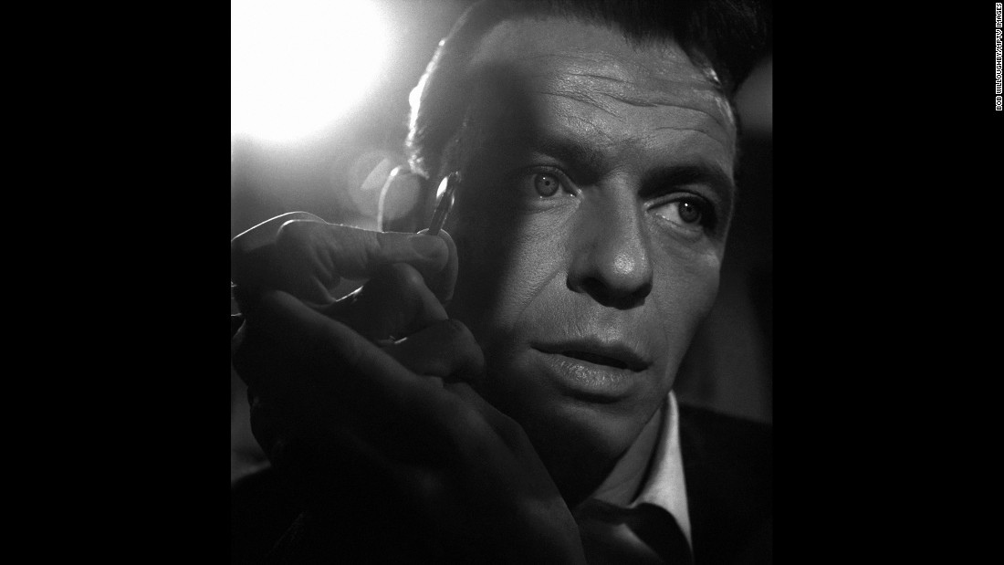 "As an actor, Sinatra was willing to take on some tough roles. In 1955's ""The Man with the Golden Arm,"" he plays a heroin-addicted drummer and card dealer trying to go straight. In this image, he holds a match up to his dilated eyes, right before a scene in which Kim Novak's character does the same to him, checking to see if he's still using. Sinatra's performance earned him a best actor Oscar nomination."