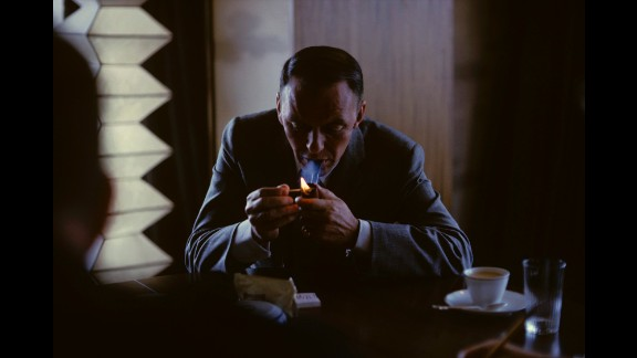 """For all his standing in public life, Sinatra liked solitude, and many images show him pensive and thoughtful. This shot was taken in Tokyo in 1962. Sinatra said of his pipe-smoking, """"It helps me think straight."""" He died on May 14, 1998. He was 82."""