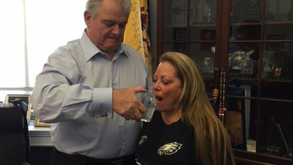 Rep. Bob Brady in his office sharing a glass of water previously used by Pope Francis with his wife, Debra Brady.