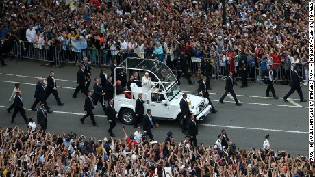 NEW YORK, NY - SEPTEMBER 25:  Thousands of people watch Pope Francis ride in the popemobile through Central Park on September 25, 2015 in New York City. The pope is in New York on a two-day visit carrying out a number of engagements, including celebrating Mass in Madison Square Garden.  (Photo by Justin Sullivan/Getty Images)