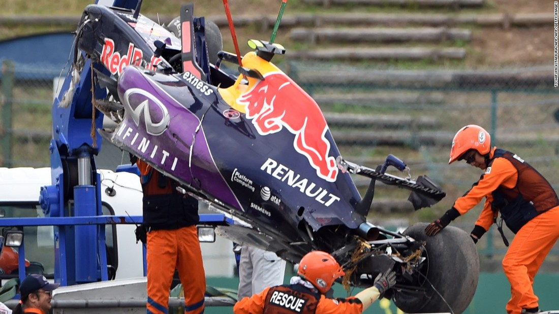 The race car of Red Bull driver Daniil Kvyat of Russia is moved onto a truck after his crash in the qualifying session at the Formula One Japanese Grand Prix in Suzuka.